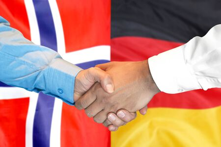 Business handshake on the background of two flags. Men handshake on the background of the Norway and Germany flag. Support concept