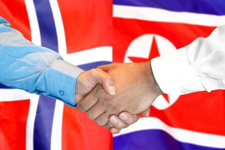 Business handshake on the background of two flags. Men handshake on the background of the Norway and North Korea flag. Support concept