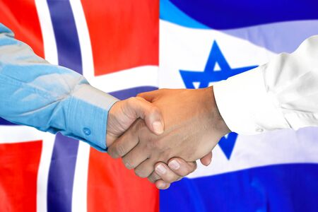Business handshake on the background of two flags. Men handshake on the background of the Norway and Israel flag. Support concept