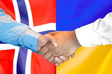 Business handshake on the background of two flags. Men handshake on the background of the Norway and Ukraine flag. Support concept Banco de Imagens