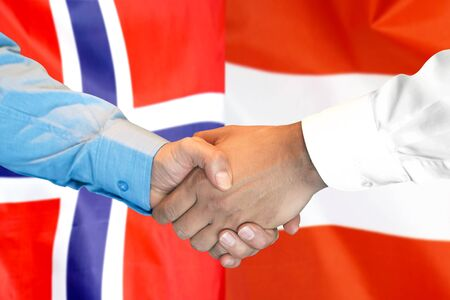 Business handshake on the background of two flags. Men handshake on the background of the Norway and Austria flag. Support concept