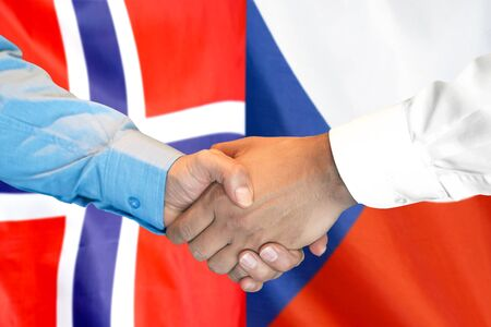 Business handshake on the background of two flags. Men handshake on the background of the Norway and Czech Republic flag. Support concept