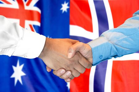 Business handshake on the background of two flags. Men handshake on the background of the Norway and Australia flag. Support concept