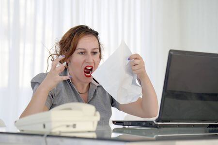 Office worker woman reading negative news in letter. Shocked beauty girl business manager received layoff message letter from company feeling surprised. An agitated girl without joy.