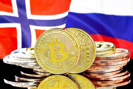 Concept for investors in cryptocurrency and Blockchain technology in the Norway and Russia. Bitcoins on the background of the flag Norway and Russia.