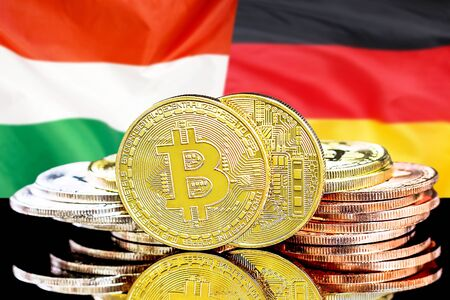Concept for investors in cryptocurrency and Blockchain technology in the Hungary and Germany. Bitcoins on the background of the flag Hungary and Germany.