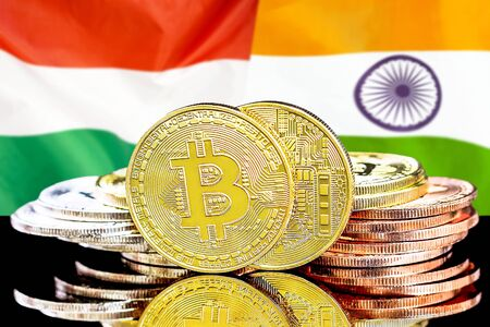 Concept for investors in cryptocurrency and Blockchain technology in the Hungary and India. Bitcoins on the background of the flag Hungary and India.