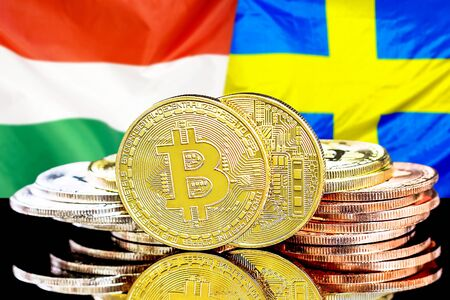 Concept for investors in cryptocurrency and Blockchain technology in the Hungary and Sweden. Bitcoins on the background of the flag Hungary and Sweden.