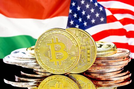 Concept for investors in cryptocurrency and Blockchain technology in the Hungary and United States of America. Bitcoins on the background of the flag Hungary and US.