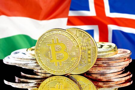 Concept for investors in cryptocurrency and Blockchain technology in the Hungary and Iceland. Bitcoins on the background of the flag Hungary and Iceland.