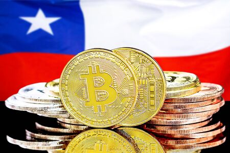 Concept for investors in cryptocurrency and Blockchain technology in the Chile. Bitcoins on the background of the flag Chile.