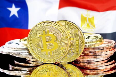 Concept for investors in cryptocurrency and Blockchain technology in the Chile and Egypt. Bitcoins on the background of the flag Chile and Egypt. Stock fotó