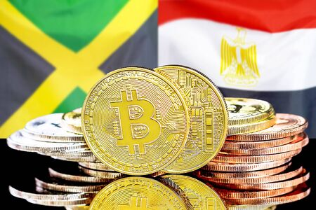 Concept for investors in cryptocurrency and Blockchain technology in the Jamaica and Egypt. Bitcoins on the background of the flag Jamaica and Egypt. Imagens