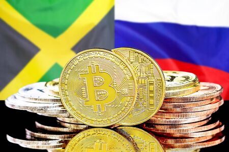 Concept for investors in cryptocurrency and Blockchain technology in the Jamaica and Russia. Bitcoins on the background of the flag Jamaica and Russia. Standard-Bild