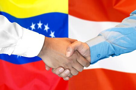 Business handshake on the background of two flags. Men handshake on the background of the Venezuela and Austria flag. Support concept