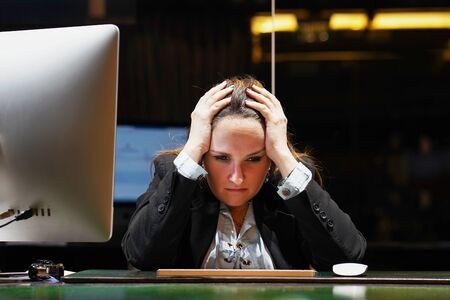 Office worker Woman suffering from headache migraine pain. Health problem, stress and depression. Female holds head with hand. Concept of health. Foto de archivo - 129513030