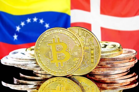 Concept for investors in cryptocurrency and Blockchain technology in the Venezuela and Denmark. Bitcoins on the background of the flag Venezuela and Denmark. Banco de Imagens