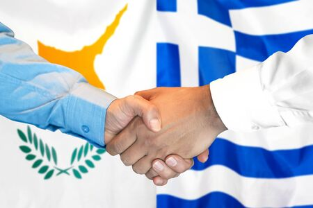 Business handshake on the background of two flags. Men handshake on the background of the Cyprus and Greece flag. Support concept