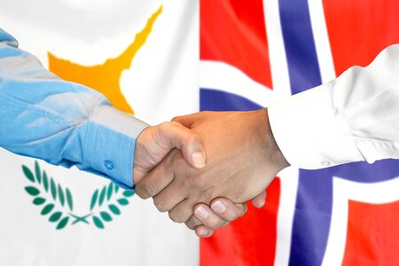 Business handshake on the background of two flags. Men handshake on the background of the Cyprus and Norway flag. Support concept 스톡 콘텐츠
