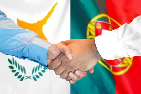 Business handshake on the background of two flags. Men handshake on the background of the Cyprus and Portugal flag. Support concept