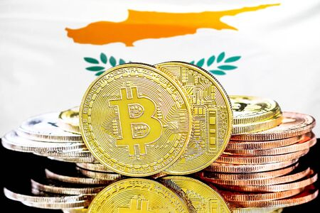 Concept for investors in cryptocurrency and Blockchain technology in the Cyprus. Bitcoins on the background of the flag Cyprus.