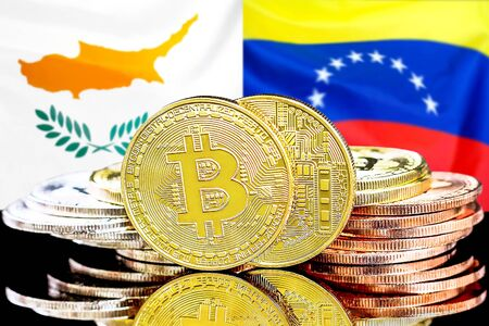 Concept for investors in cryptocurrency and Blockchain technology in the Cyprus and Venezuela. Bitcoins on the background of the flag Cyprus and Venezuela.