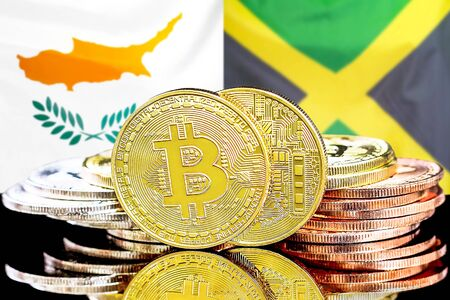 Concept for investors in cryptocurrency and Blockchain technology in the Cyprus and Jamaica. Bitcoins on the background of the flag Cyprus and Jamaica.