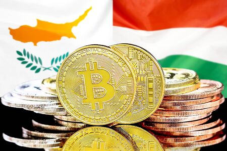 Concept for investors in cryptocurrency and Blockchain technology in the Cyprus and Hungary. Bitcoins on the background of the flag Cyprus and Hungary. Banco de Imagens