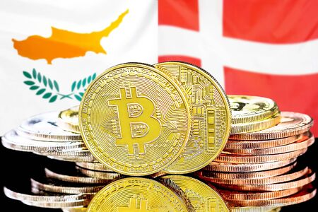 Concept for investors in cryptocurrency and Blockchain technology in the Cyprus and Denmark. Bitcoins on the background of the flag Cyprus and Denmark.
