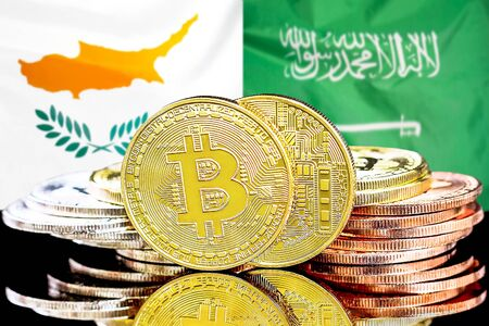 Concept for investors in cryptocurrency and Blockchain technology in the Cyprus and Saudi Arabia. Bitcoins on the background of the flag Cyprus and Saudi Arabia.
