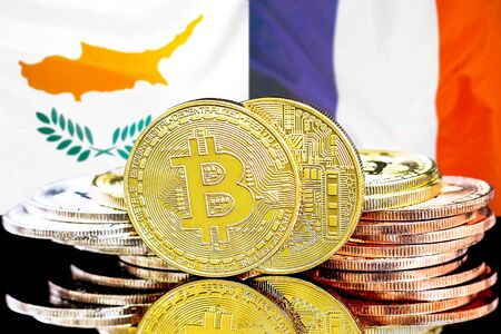 Concept for investors in cryptocurrency and Blockchain technology in the Cyprus and France. Bitcoins on the background of the flag Cyprus and France.