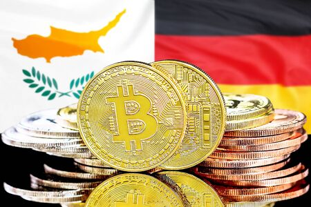 Concept for investors in cryptocurrency and Blockchain technology in the Cyprus and Germany. Bitcoins on the background of the flag Cyprus and Germany.
