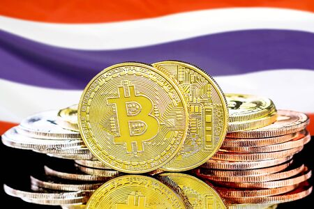Concept for investors in cryptocurrency and Blockchain technology in the Thailand. Bitcoins on the background of the flag Thailand.
