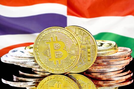 Concept for investors in cryptocurrency and Blockchain technology in the Thailand and Hungary. Bitcoins on the background of the flag Thailand and Hungary.