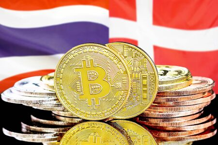 Concept for investors in cryptocurrency and Blockchain technology in the Thailand and Denmark. Bitcoins on the background of the flag Thailand and Denmark.