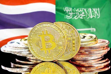 Concept for investors in cryptocurrency and Blockchain technology in the Thailand and Saudi Arabia. Bitcoins on the background of the flag Thailand and Saudi Arabia.