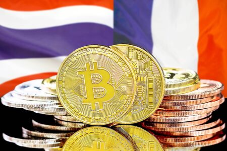 Concept for investors in cryptocurrency and Blockchain technology in the Thailand and France. Bitcoins on the background of the flag Thailand and France.