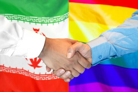 Business handshake on the background of two flags. Men handshake on the background of the Iran and LGBT gay flag. Support concept Stockfoto