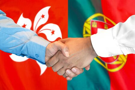 Business handshake on the background of two flags. Men handshake on the background of the Hong Kong and Portugal flag. Support concept