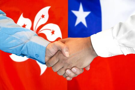 Business handshake on the background of two flags. Men handshake on the background of the Hong Kong and Chile flag. Support concept