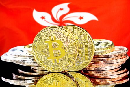 Concept for investors in cryptocurrency and Blockchain technology in the Hong Kong. Bitcoins on the background of the flag Hong Kong.