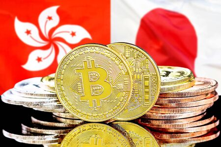 Concept for investors in cryptocurrency and Blockchain technology in the Hong Kong and Japan. Bitcoins on the background of the flag Hong Kong and Japan.