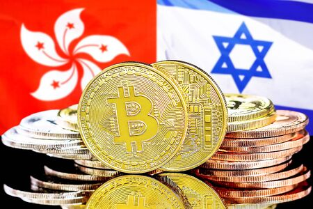 Concept for investors in cryptocurrency and Blockchain technology in the Hong Kong and Israel. Bitcoins on the background of the flag Hong Kong and Israel.