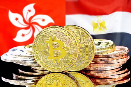 Concept for investors in cryptocurrency and Blockchain technology in the Hong Kong and Egypt. Bitcoins on the background of the flag Hong Kong and Egypt.