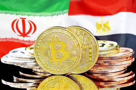 Concept for investors in cryptocurrency and Blockchain technology in the Iran and Egypt. Bitcoins on the background of the flag Iran and Egypt.