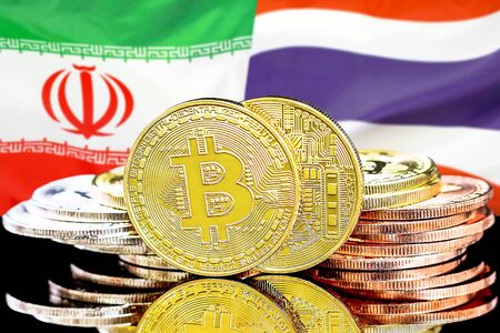 Concept for investors in cryptocurrency and Blockchain technology in the Iran and Thailand. Bitcoins on the background of the flag Iran and Thailand.
