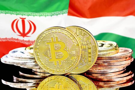 Concept for investors in cryptocurrency and Blockchain technology in the Iran and Hungary. Bitcoins on the background of the flag Iran and Hungary. Banco de Imagens