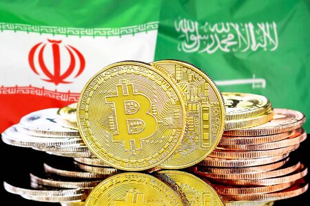 Concept for investors in cryptocurrency and Blockchain technology in the Iran and Saudi Arabia. Bitcoins on the background of the flag Iran and Saudi Arabia. Banco de Imagens