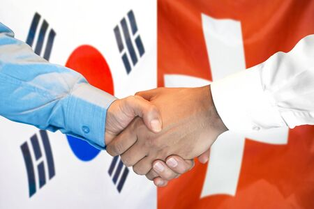 Business handshake on the background of two flags. Men handshake on the background of the South Korea and Switzerland flag. Support concept