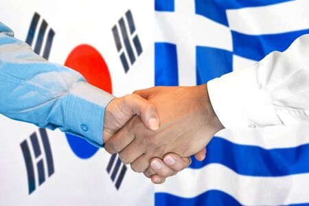 Business handshake on the background of two flags. Men handshake on the background of the South Korea and Greece flag. Support concept